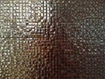 Kleine kupferne Fliese auf der Wand Licht denken über Oberfläche nach, die Schwellenbeschaffenheit ist stockfotografie
