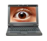 Kleine laptop met oog op het scherm Royalty-vrije Stock Afbeeldingen