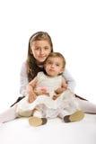 Kleine Mädchen auf weißem Hintergrund Lizenzfreie Stockbilder