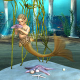 Kleine Meerjungfrau, die Anemone Flower hält Stockbilder