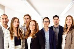Kleine Onderneming Team In Their Office Stock Afbeelding