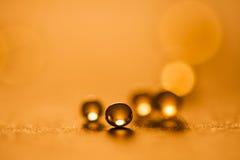 Kleine, orange Ballzusammenfassung mit bokeh Lizenzfreie Stockfotografie