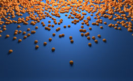 Kleine Oranje Ballen die langs de Blauwe Oppervlakte glijden Royalty-vrije Stock Afbeelding