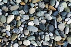Kleine overzeese stenen, grint stock foto's