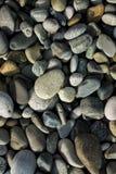 Kleine overzeese stenen, grint achtergrondtextuur stock afbeeldingen