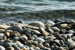 Kleine overzeese stenen, kiezelstenen stock afbeeldingen