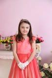 Kleine Prinzessin mit rosa Kleid Stockfoto