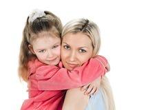 Kleine Tochter der jungen Mutter Lizenzfreies Stockbild