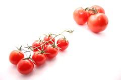 Kleine tomaten en grote tomaten Stock Afbeeldingen