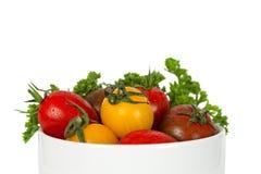 Kleine tomaten in kom Royalty-vrije Stock Foto's