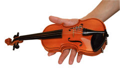 Kleine Violine in einer Hand Stockfotografie