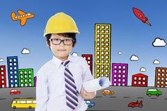 Kleiner Architekt und ein Stadtbild Stockbilder