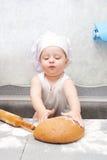 Kleiner Bäcker- oder Kochjunge stockfotografie