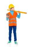 Kleiner Bauarbeiter mit einem Geistniveau Lizenzfreies Stockbild