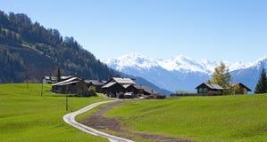 Kleiner Bauernhof in den Schweizer Alpen Lizenzfreies Stockfoto