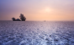 Kleiner Bauernhof im Winter Stockfotografie