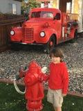 Kleiner Feuerwehrmann Lizenzfreies Stockbild