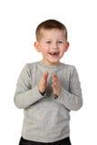Kleiner froh klatschender Junge stockfotos