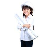 Kleiner Ingenieur, kleines Mädchen im Bausturzhelm mit einem p Lizenzfreie Stockbilder