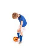 Kleiner Junge als Fußballspieler Lizenzfreie Stockfotos