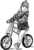 Kleiner Junge auf dem Fahrrad Stockbild