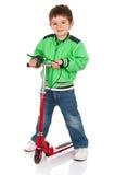 Kleiner Junge auf dem Roller Stockfotografie
