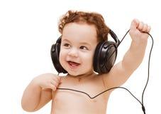Kleiner Junge in den Kopfhörern stockfotos