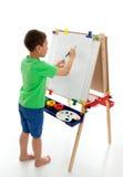 Kleiner Junge, der beginnt, eine Abbildung zu malen Lizenzfreies Stockbild