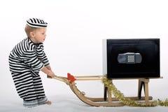 Kleiner Junge in der Diebausstattung Stockfotografie