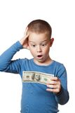 Kleiner Junge, der Dollar anhält Stockfotos