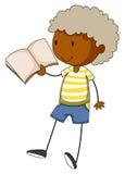 Kleiner Junge, der ein Buch liest Stockbild