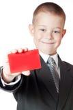 Kleiner Junge, der ein Leerzeichen anhält Stockfotografie