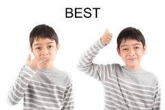 Kleiner Junge, der Handzeichen BESTE ASL-Gebärdensprache macht Stockfotografie