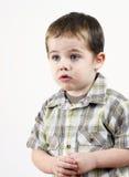 Kleiner Junge in der Mühe Lizenzfreie Stockfotos