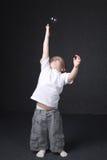 Kleiner Junge, der mit Luftblase spielt Stockbilder