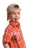 Kleiner Junge, der seine Zunge zeigt stockbild