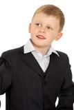 Kleiner Junge in einer Klage lizenzfreie stockfotografie