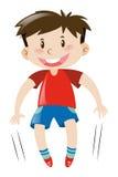 Kleiner Junge im rotem Hemdspringen Stockfotos