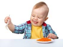 Kleiner Junge lehnt ab zu essen Stockbild