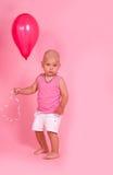 Kleiner Junge mit Ballon Stockfotos