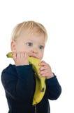 Kleiner Junge mit Banane Stockfoto
