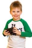 Kleiner Junge mit einer Kamera stockfotos