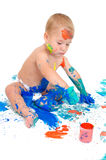 Little boy paints with finger colors Stock Images