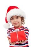Kleiner Junge mit Geschenk Stockbild