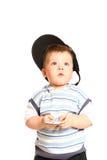 Kleiner Junge mit Handy auf einem weißen Hintergrund Lizenzfreie Stockfotografie