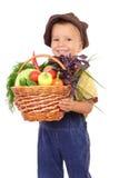 Kleiner Junge mit Korb des Gemüses Stockbilder