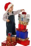 Kleiner Junge mit Lot Weihnachtsgeschenkkästen Lizenzfreie Stockfotografie