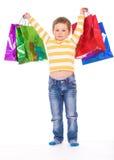 Kleiner Junge mit Paketen Stockbilder