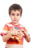 Kleiner Junge mit piggy Querneigung stockbild