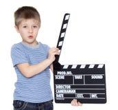 Kleiner Junge mit Scharnierventil Stockfotografie